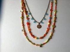Three Strand Gypsy BoHo Necklace in Yellow Orange Green and blue with Charms and a Beautiful Mandala Stone Jewelry, Boho Jewelry, Jewelry Crafts, Beaded Jewelry, Handmade Jewelry, Jewelry Design, Multi Layer Necklace, Wire Wrapped Necklace, How To Make Necklaces