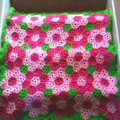 Hexagon Rose Garden - pattern:Garden Coverlet / Bright Flower Throw by Lion Brand Yarn