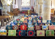 A display of kneelers in the nave at Bourne Abbey