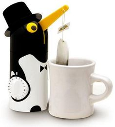 Tea bag timer/remover. ohmygosh! I need him!