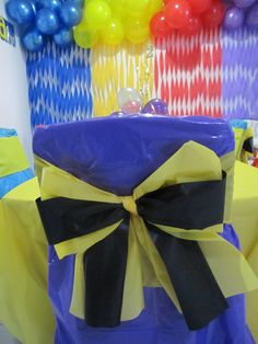 Allegra's 2nd Birthday Party - The Wiggles - Cut up plastic tablecloths to make chair covers & Emma bows