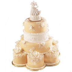 Ivory Grandeur Cake - This design surely takes the cake! Decorated with fondant flowers and delicate sotas, this cake will captivate your guests.