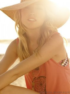 Sun going down, warm sand, soft cotton tank over your bathing suit, floppy hat and beach hair... Perfect