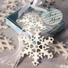Perfect for a winter wedding or any elegant affair, our Let It Snow Collection snowflake bookmark favor is one of a kind Everyone loves to curl up with a favorite book on a snowy winter's day. And these elegant snowflake bookmark favors make each Winter Wedding Receptions, Winter Wedding Favors, Christmas Party Favors, Unique Wedding Favors, Christmas Wedding, Unique Weddings, Wedding Gifts, Wedding Ideas, Winter Weddings