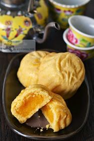 Mini baked egg custard mooncakes with custard filling and custard pastry. I want to try putting salted duck egg yolks in!