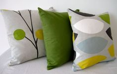 Geometric retro green yellow, duck-egg blue, grey and white cushion Cover, contemporary designer fabric slip cover, throw pillow. $25.00, via Etsy.