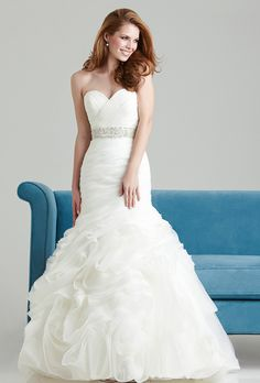 Brides: Allure Romance . A flattering fit and flare silhouette. This gown features a fitted strapless, sweetheart bodice that is ruched asymmetrically,  and is accented with a Swarovski crystal sash.��See Allure Bridals on YouTube  Get wedding dress preservation in the Richmond,Va area from the best.  Visit us at olddominioncleaners.com