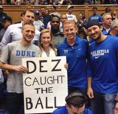 """How do you get Tony Romo, DeMarco Murray, Jason Witten and Dallas Cowboys coach Jason Garrett to take a picture with you? Have a """"Dez caught the ball"""" sign with you at all times. :)"""