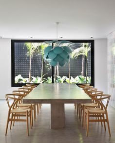 The dining-room table was designed by the architect and built in concrete during the construction phase - DM House by Studio Guilherme Torres (22)