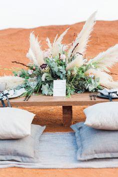 Organic Pillows for a Modern Bohemian Sweetheart Table https://heyweddinglady.com/natural-bohemian-wedding-red-desert/ #wedding #weddingideas #weddingdetails #southafrica #bohemianwedding #bohobride #destinationwedding #sweethearttable #weddingdecor #centerpiece #floraldesign