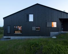 This Cabin by Oslo studio Lund Hagem features blackened timber and concrete elevations that hunker down to protect it from the winter weather.