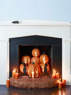 If you're always thinking you don't use your fireplace enough, this fun decoration was made for you. Carve flames into pumpkins for a cozy atmosphere this fall.