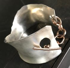 Sterling cuff with gold toggle