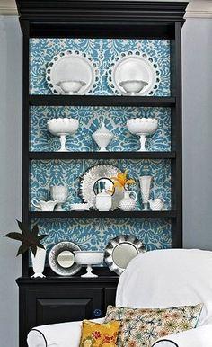 Black hutch with blue baroque wallpaper background... Delightful design!