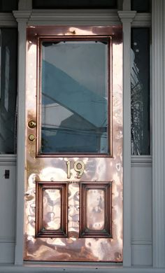 Copper door that will patina over time. Metal is one of the greatest trends for home, outdoor hotel or apartment decor. You should use it in any objects: coould be chandeliers, foot lamps, chairs or another accessories. See more ideas here: http://www.pinterest.com/delightfulll/