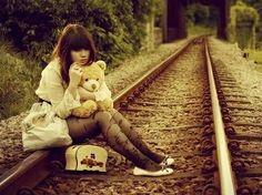 Cute girl • railroad • teddy bear • plush