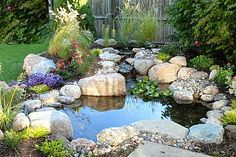 small water gardens, outdoor living, patio, ponds water features, This 4 pond was installed using a DIY kit It sits right next to the patio providing a great view Backyard Water Feature, Ponds Backyard, Patio Pond, Backyard Waterfalls, Large Backyard, Pond Landscaping, Landscaping With Rocks, Landscaping Company, Tropical Landscaping
