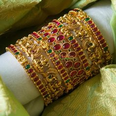 Check out the best imitation bangle designs from the popular jewellery brand Vriksham. Plain Gold Bangles, Ruby Bangles, Gold Bangles Design, Bridal Bangles, Gold Earrings Designs, Gold Jewellery Design, Indian Gold Bangles, Unique Earrings, Diamond Bangle