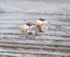 Gold gemstone stud earrings. White topaz posts in by RimmaJewelry