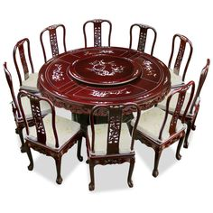 66in Rosewood Pearl Inlay Design Round Dining Table with 10 Chairs. Mother-of-pearl decoration is hand-inlaid throughout the entire table. A removable lazy Susan situates in the center providing convenience for passing the dishes. Dark cherry finish. Oriental Rosewood dining set.