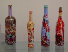 YES. wine bottles. shake paint around inside, paint on outisde, scrape thru words on outside.