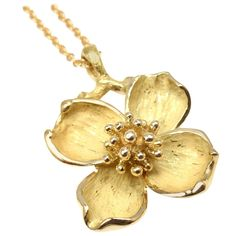 I love the dogwood tree, this is the first time ive ever seen it in gold. K. Tiffany & Co. gold Dogwood Flower Pendant Necklace | From a unique collection of vintage drop necklaces at https://www.1stdibs.com/jewelry/necklaces/drop-necklaces/