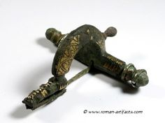 """Early 4th century crossbow fibula.  """"The online collection of Roman artifacts"""".http://www.roman-artifacts.com/Index.htm"""