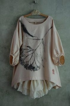 Tunic with gathered balloon sleeves.