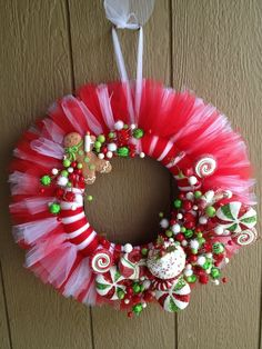 Christmas candy tulle wreath--would do solid red or green tulleChristmas Candy Tulle Wreath - no instructions but easy enough to do.Adorable Christmas Wreath Ideas For Your Front Door of thanksgiving tulle wreathsMagnificent DIY tulle wreath Tulle Crafts, Wreath Crafts, Christmas Projects, Holiday Crafts, Wreath Ideas, Christmas Crafts For Gifts For Adults, Christmas Candy Crafts, Tulle Projects, Gift Crafts