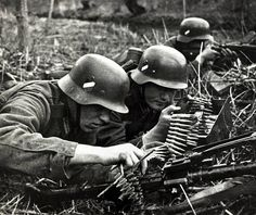 1940 German soldiers prepare to support a river crossing with light machine gun fire on the western front Germany's victory in France in German Soldiers Ww2, German Army, Phoney War, Mg34, History Icon, German Helmet, Germany Ww2, Man Of War, German Uniforms