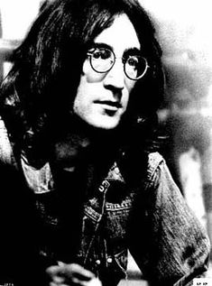 """Some special on John Lennon,"""" replied Z, taking the joint and lighting it with a cigarette. Description from mrzine.monthlyreview.org. I searched for this on bing.com/images"""