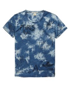 Indigo tee in tie-dye and dip-bleach treatment with placement prints