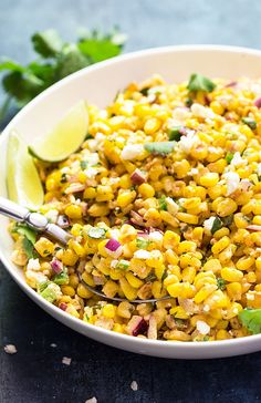 Mexican Corn Salad - Creamy, cheesy and perfectly seasoned corn with red onions, jalapenos and feta cheese.