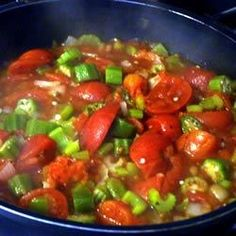 Okra is sauteed in bacon grease with onion, green pepper, celery, and stewed tomatoes in this simple side dish.