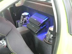 This install features two subwoofers and two amps behind the front seats. Custom Car Audio, Custom Cars, Custom Speaker Boxes, Car Audio Installation, Car Audio Systems, Car Sounds, Air Ride, Knock Knock, Interior Ideas