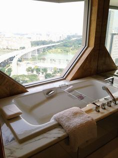 This bathtub was made for relaxation. It's at The Ritz-Carlton, Millenia Singapore.