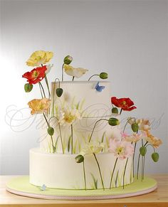 poppy summer wedding cake with blue butterflies
