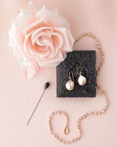 Pink Pearls    A black-headed pin would look striking pierced into a rose boutonniere, and the rose cast of these pearls looks decidedly new. The freshwater-pearl earrings and opal-and-pink-pearl necklace are by Ted Muehling.