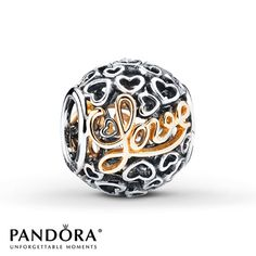 "The word ""Love"" is spelled in 14K yellow gold script letter against an openwork background of sterling silver heart outlines in this charm from the PANDORA 2015 Valentine's Day collection. Style # 791425."