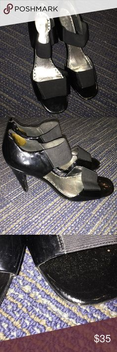 Black BCBG heels Open toed BCBG black shiny heels are in used condition with scuff on toe and a few marks on heel. Could clean up nicely . BCBG Shoes Heels
