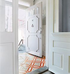 Tile floor entrance - all else light, white and reduced.