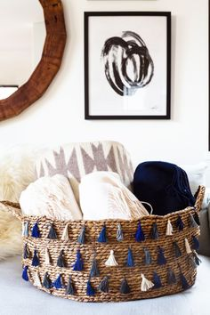 With a toddler who has accumulated an excessive collection of toys, a familywho has an obsession with cashmerethrow blankets, and a DIYer (that would be me)who purchasesway too much yarn, baskets are essential in our family. So when designing our living roomwith One Kings Lane, stylist