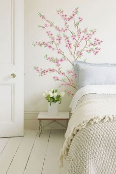 Pretty pink hand painted blossoms for a feminine shabby chic bedroom
