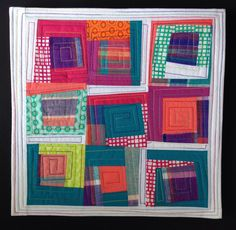 Wonky log cabin squares make up this bright & cheery modern quilt. Made up of center squares of a madras plaid surrounded by teal, peach, orange,
