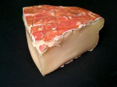 Paesanella, from the Ciresa Family, is produced in the Val Taleggio, an Alpine valley of Lombardy, Italy — best known for its namesake cheese. The rind is pink and sticky, with a bit of sandy grit to it (a quality often seen in washed rinds, it comes from the deposit of minerals after repeated washes with a salty brine). The paste is soft and bulging, with a creamy texture and a mild barny pungency. In flavor it is sweet, meaty and full with mushroom and hay notes.