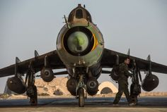 fighter jet at the Syrian Air Force base in Homs province Military Helicopter, Military Aircraft, Luftwaffe, Syrian Civil War, Air Force Aircraft, Russian Air Force, Military News, Sukhoi, Jet Engine