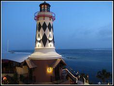 Harbor Walk Village lighthouse at dusk.  Destin, FL
