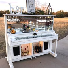Old upright piano re-purposed into a bar.