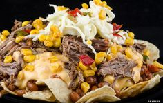 Just in time for the All-Star festivities, crisp tortilla chips topped with smoked brisket, baked beans, cheesy corn, coleslaw and barbeque sauce