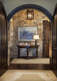 Paula Berg Design Associates | Natural stone and lighting for a welcoming ambiance